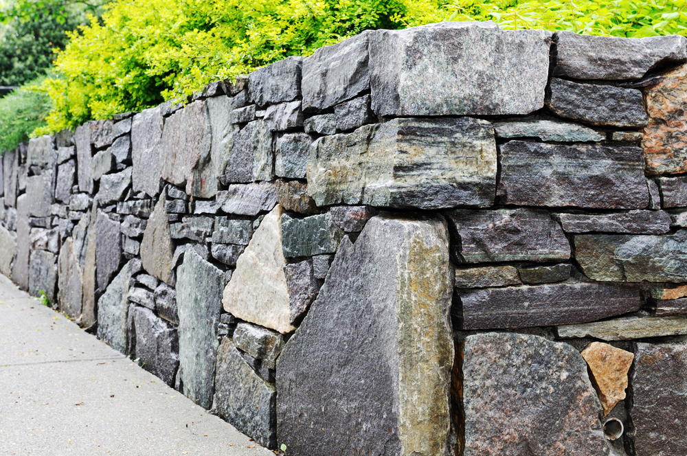 Delightful A Retaining Wall Is A Strong Wall Built To Retain Soil Mass In Addition To  Improving The Aesthetics Of A Place. An Attractive Retaining Wall With The  ...